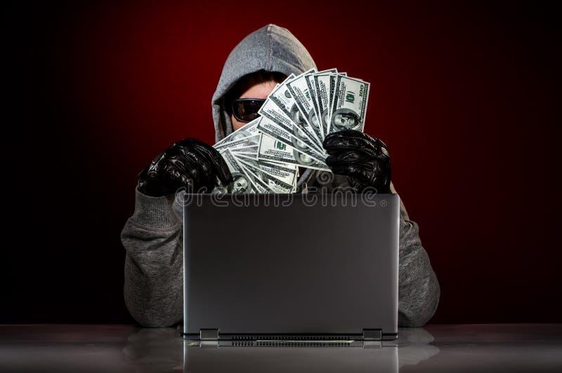 Hacker i pieniądze zdjęcia stock