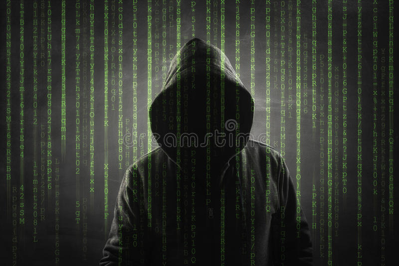 Hacker over a green screen with binary code stock images