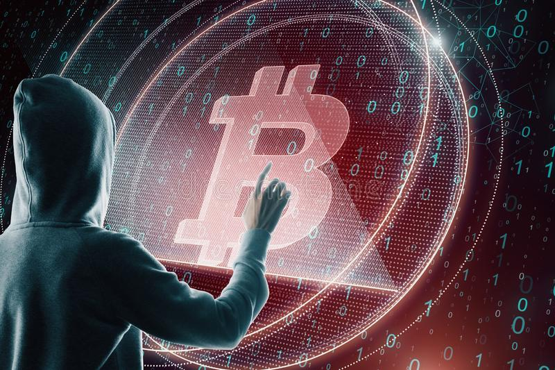 Hacker with red bitcoin royalty free stock photo