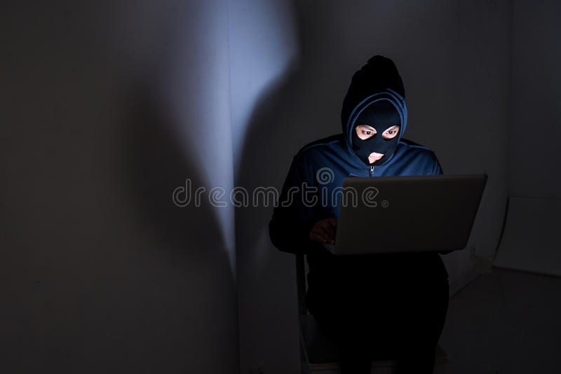Hacker. Stealing data from the laptop stock photography
