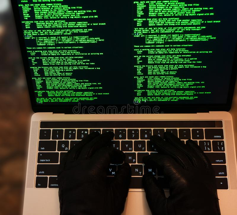 Hacker stealing password and identity, computer crime. Lots of digits on the computer screen. Top view. Computer crime concept, hacker breaching the site. Lots stock images