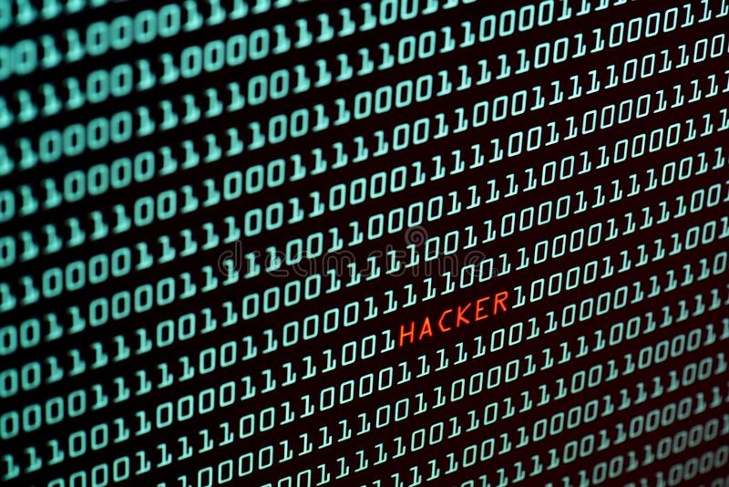 Hacker text and binary code concept from the desktop screen, selective focus stock photo