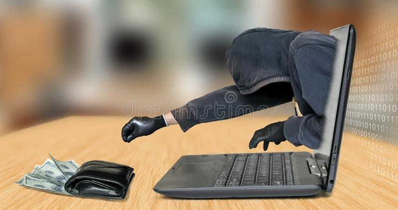 Hacker - thief steals money from laptop royalty free stock photos