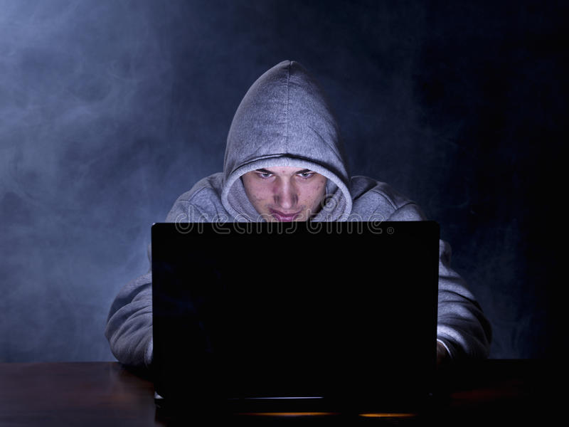 Hacker. Trying to breach the security of a computer system stock images