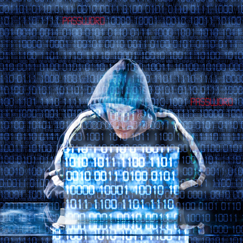 Hacker typing on a laptop. With binary code in background stock photo