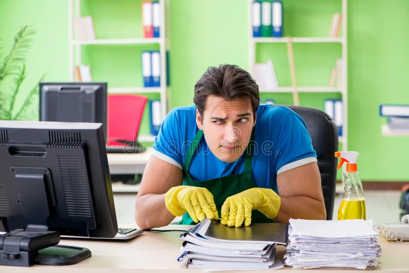 The hacker under professional cleaner cover stealing personal data royalty free stock photos