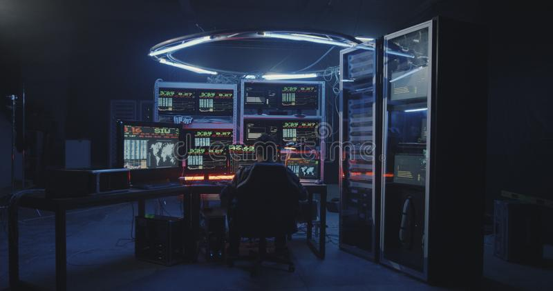 Hacker using computer with multiple monitors royalty free stock photography