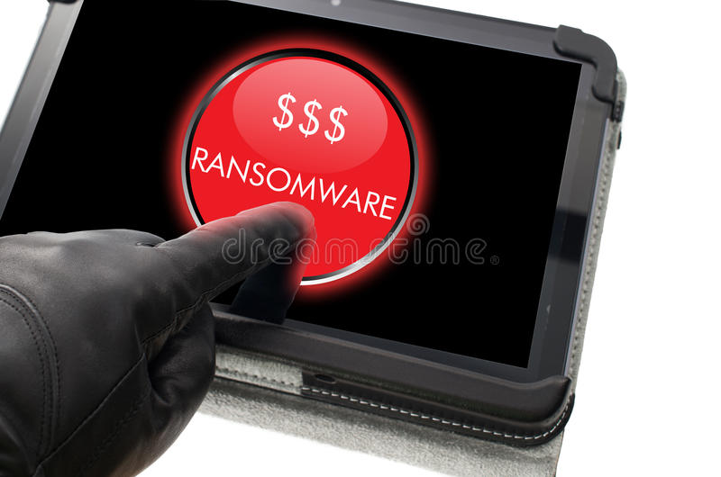 Hacker wearing black glove clicking on ransomware. Button on a virtual touch screen stock photos