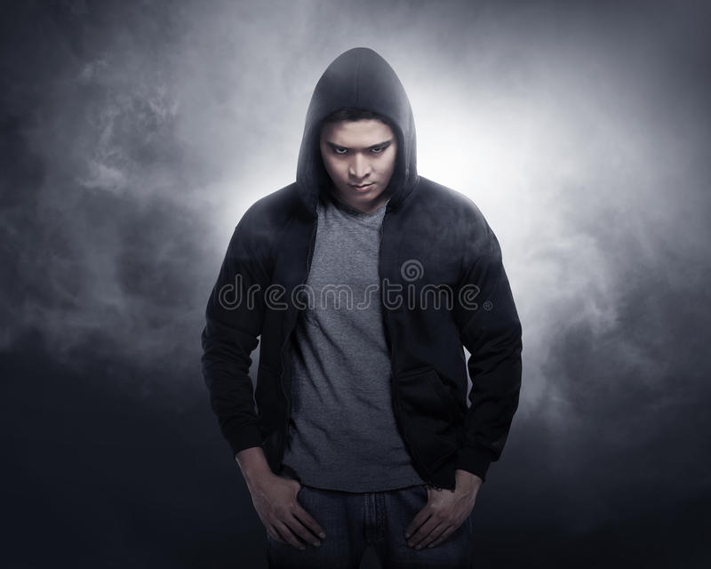 Hacker wearing hoodie shirt stock photography