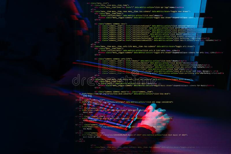 Hacker working with computer in dark room with digital interface around. Image with glitch effect. Hacker working with computer in dark room with digital stock image
