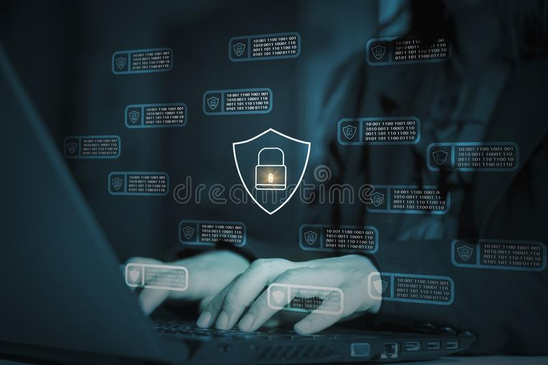 Hackers attack laptop computer with background icon binary, shield and padlock,concept preventing website attacks by keeping royalty free stock photography