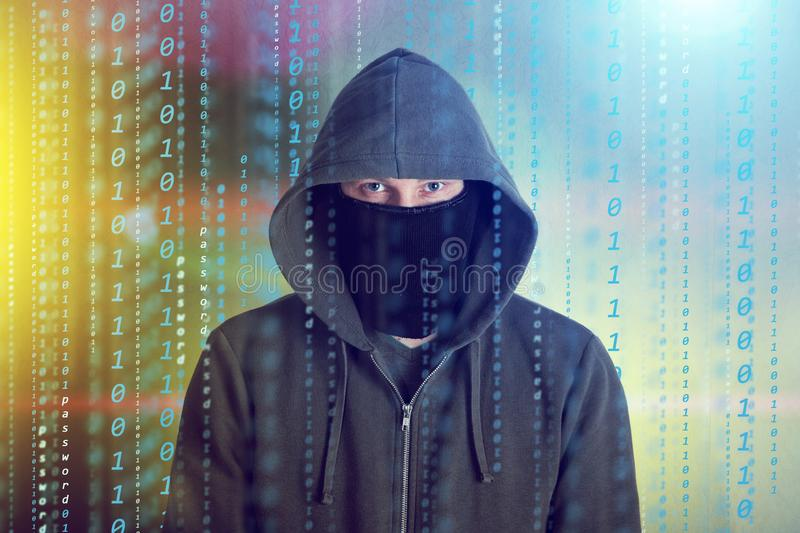 Hackers programmer look on screen and writes the program code hack information and user account stock photo