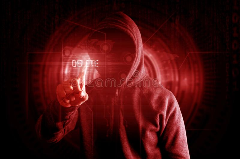Hackers touch delete button to delete data Virus attack concept. stock photography
