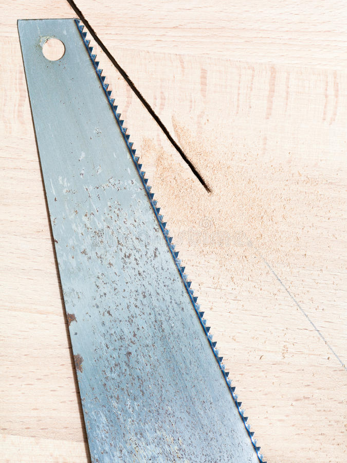 Hacksaw At Wooden Board Royalty Free Stock Photography