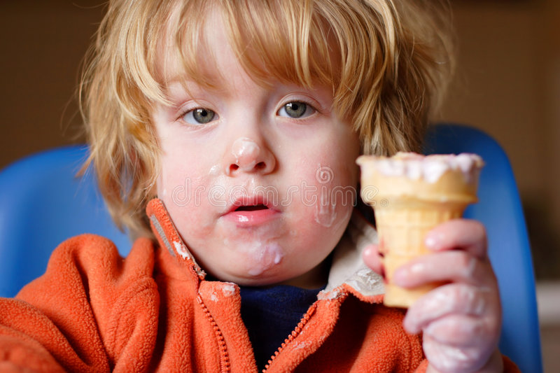 Had Enough?. A young boy eating ice cream royalty free stock images