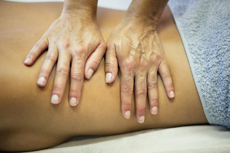 She had those healing hands. Woman at a massage in spa center. Close up. Copy space stock photos