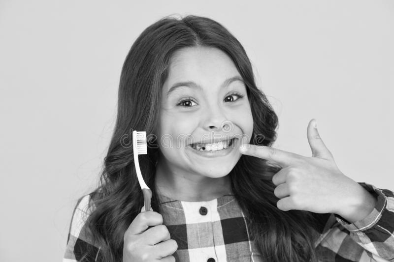 She had her baby tooth out. Happy child show milk tooth removed. Small girl with open mouth and tooth brush. Tooth fairy. Will visit her royalty free stock image