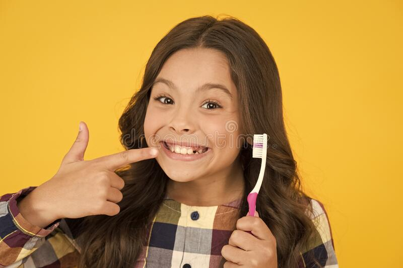 She had her baby tooth out. Happy child show milk tooth removed. Small girl with open mouth and tooth brush. Tooth fairy. Will visit her royalty free stock photography