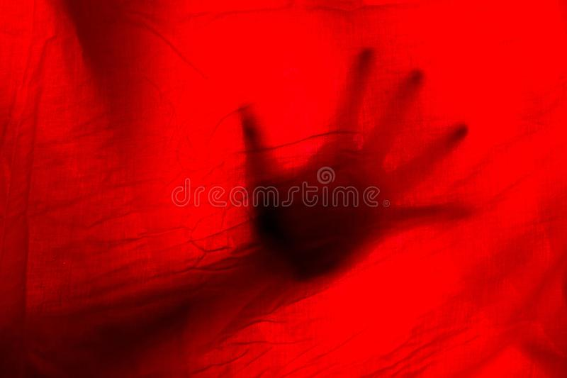 hads behand rote Vorhänge lizenzfreie stockbilder