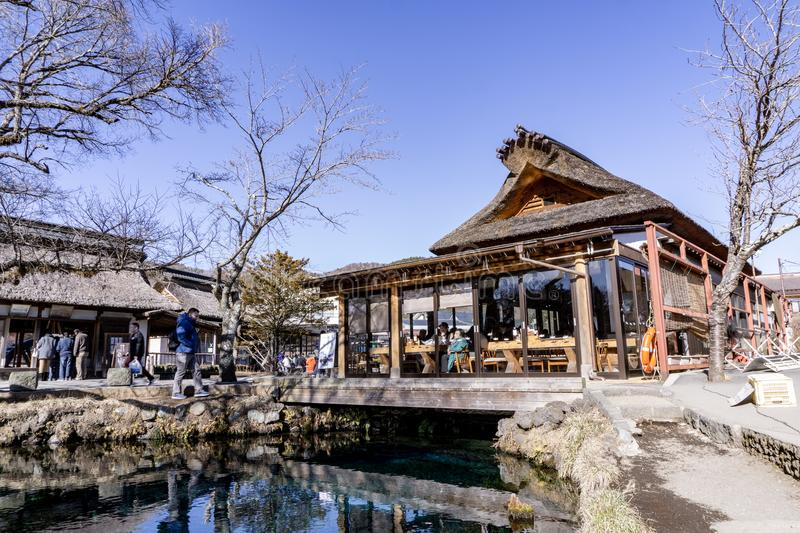 Main house and clear spring water pond in Oshino Hakkai Village a small village in the Fuji Five Lake region. royalty free stock image