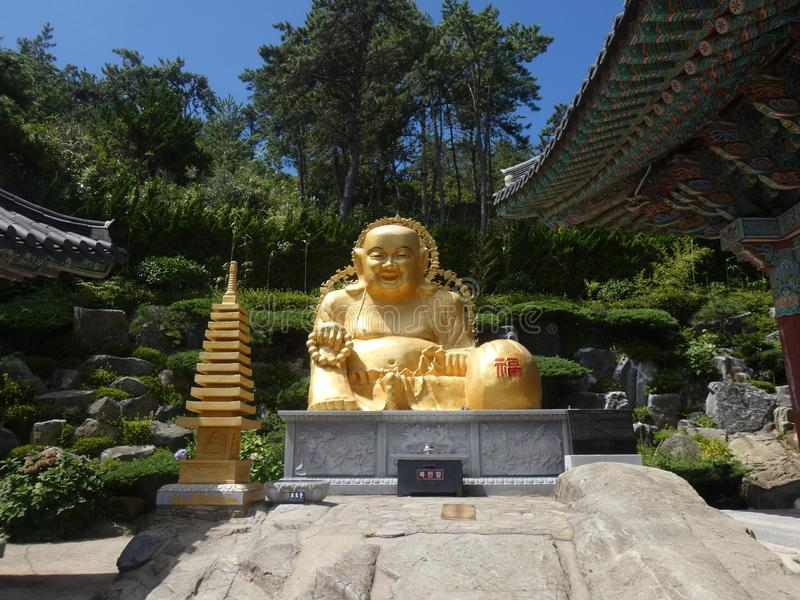 Haedong Yonggungsa. Picture of bouddha in gold at the temple `Haedong Yonggungsa` located near the sea at Busan in south Korea royalty free stock photography