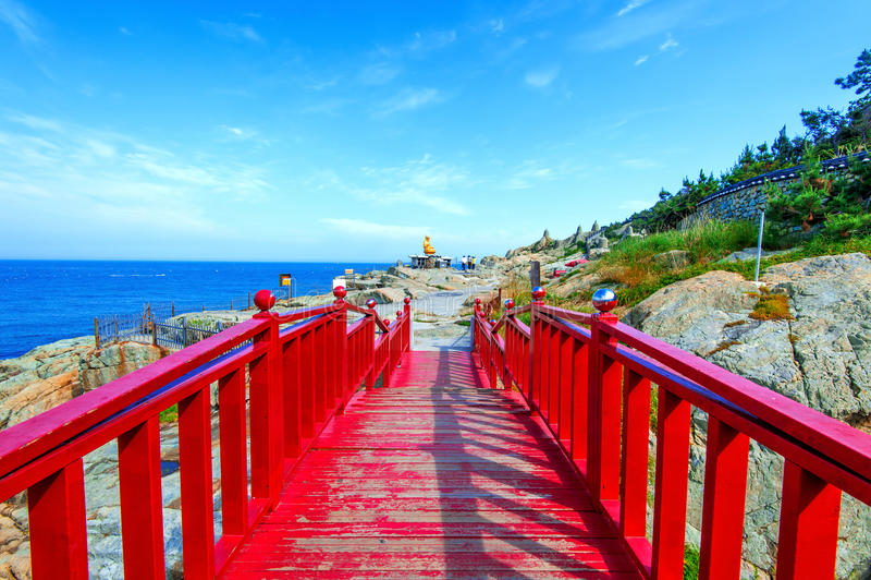 Haeundae sea and wooden bridge at Haedong yonggungsa temple in B royalty free stock photography