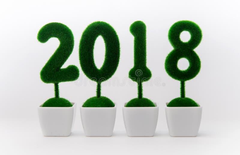Haga calendarios 2018, número 2018 compuesto por la planta del arbusto en pote en el fondo blanco fotos de archivo