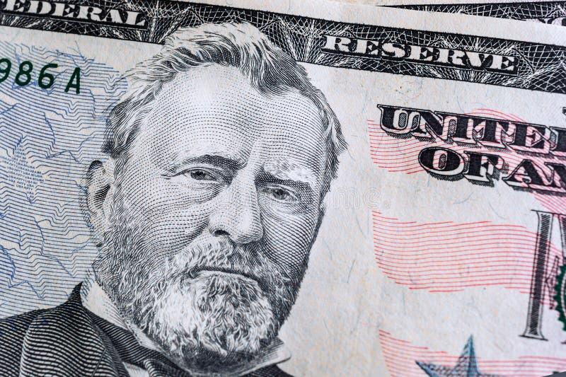 haga frente en dólares de macro de la cuenta de los E.E.U.U. cincuenta o 50, fondo de los billetes de banco foto de archivo libre de regalías