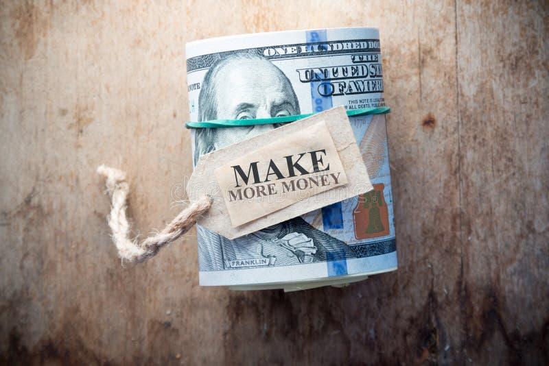 Haga más dinero imagen de archivo libre de regalías
