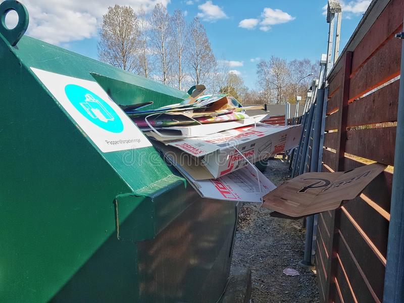Hagfors, Sweden April 23, 2019. Green recycling containers over full stock photos