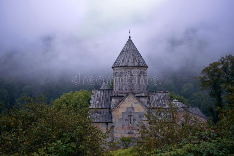 Haghartsin Monastery located near the city of Dilijan in Armenia. Covered in a dense fog and surrounded by trees very beautiful landscape stock photo