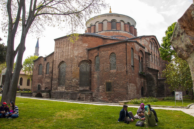 Hagia Irene, an eastern Orthodox. Istanbul,Turkey - May 7, 2017: People are sitting in front of Hagia Irene, an eastern Orthodox church located in the outer royalty free stock image