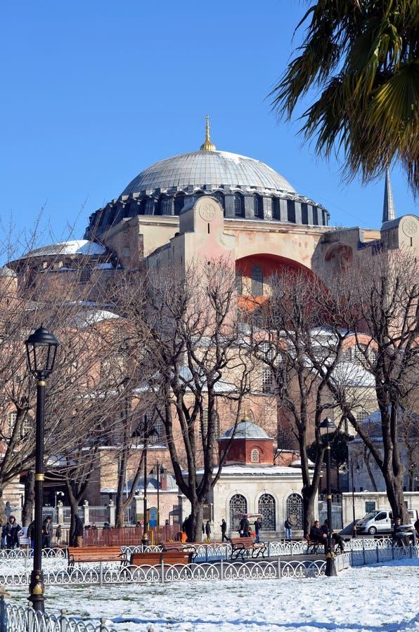 Hagia Sofia mosque in Istanbul. ISTANBUL, TURKEY - JAN 10, 2013 - Tourists at Hagia Sofia mosque in Istanbil, Turkey royalty free stock photos