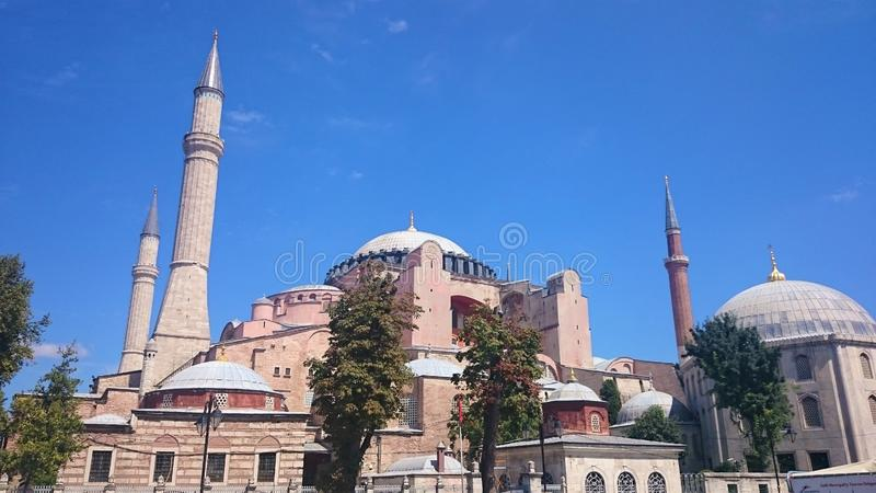 Hagia Sophia domes and minarets in the old town of Istanbul, Turkey, on sunset royalty free stock image