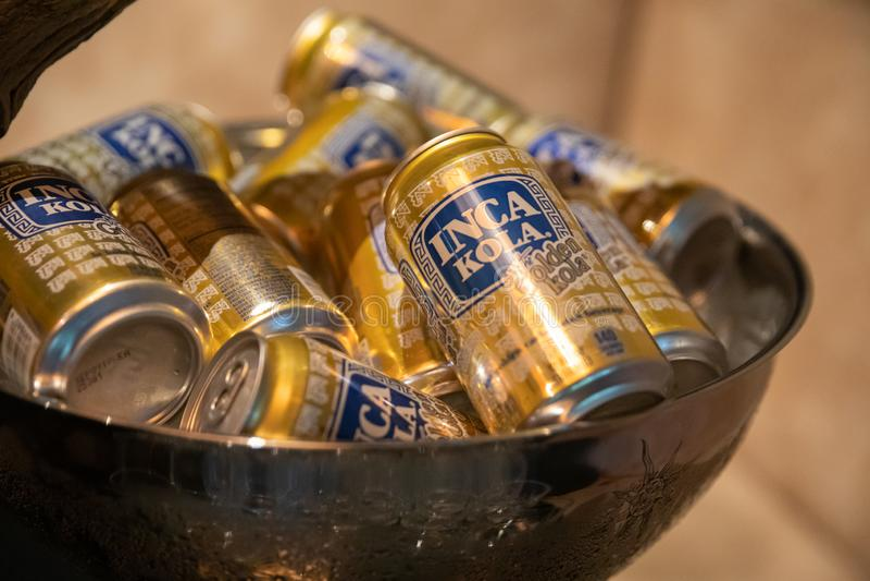 A bowl filled with peruvian inca kola cans stock photo