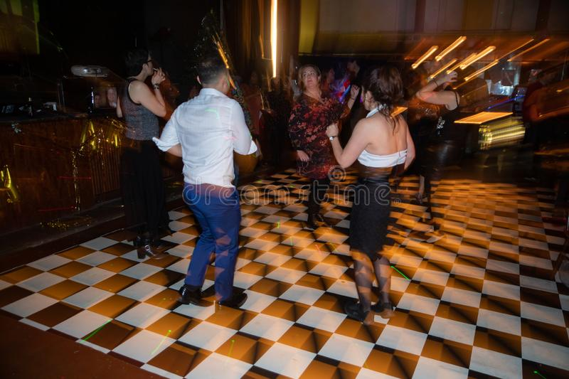 People on the black white checkered dancing floor royalty free stock image
