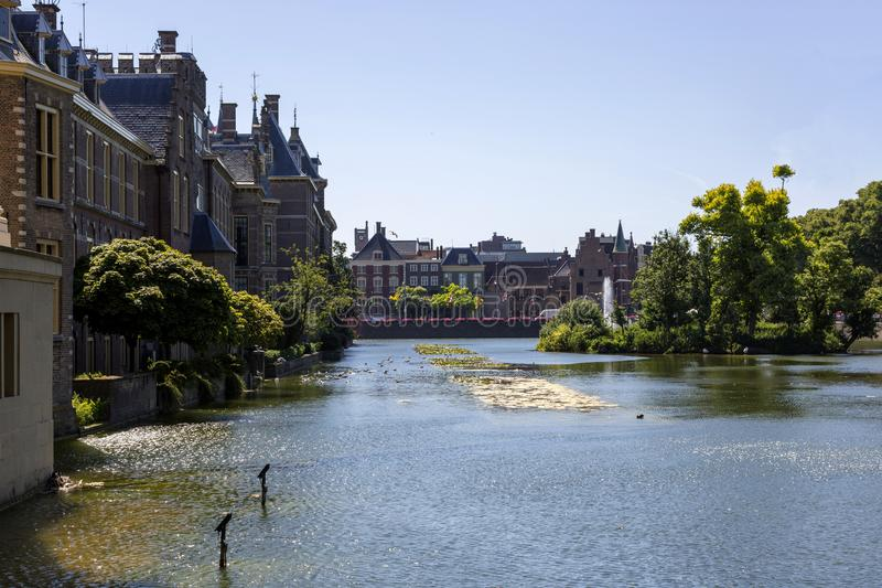View of the Binnenhof from the palace pond. The Hague, Netherlands - July 03, 2018: View of the Binnenhof from the palace pond royalty free stock photo