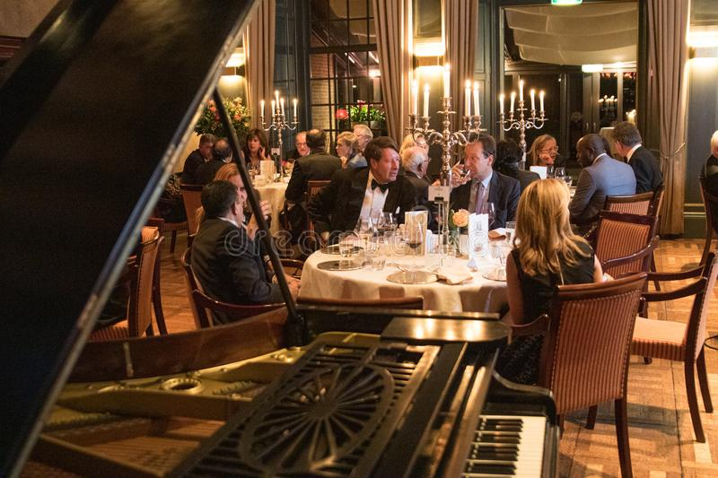 Gala dinner smoking tie grand piano castle candles royalty free stock image