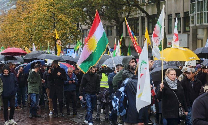 Kurdish demonstration against Turkish invasion. The Hague, The Netherlands - October 12, 2019: Kurds protest against the Turkish invasion of northern Syria in royalty free stock photo