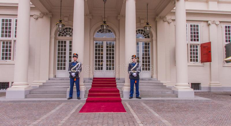 Entrance palace guards swords elegance vip visit king the hague red carpet entrance official. The Hague, Netherlands - september 23 2013 : guards are standing royalty free stock images