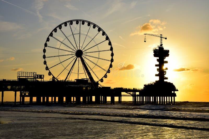 The Hague, Netherlands - September 5, 2019: Scheveningen beach. Pier and ferris wheel. royalty free stock images