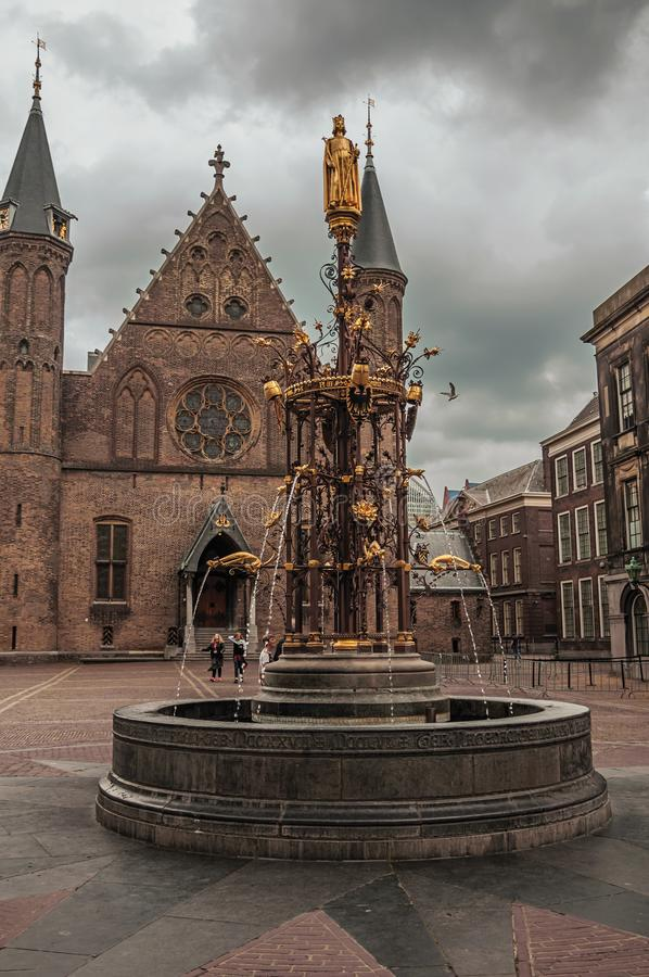 Ornate fountain in front of the gothic Ridderzaal great hall at The Hague. The Hague, western Netherlands - June 29, 2017. Ornate fountain in front of the royalty free stock photos