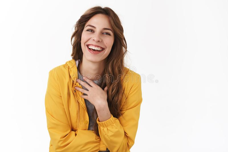 Haha funny story. Amused carefree friendly young tender pretty girl having fun laughing joyfully touch chest giggling stock image