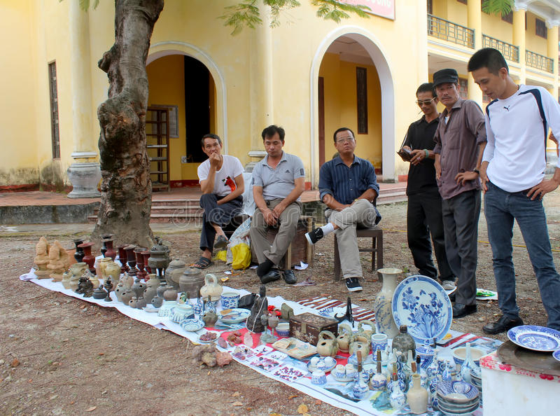 HAI DUONG, VIETNAM, October, 27: People in antiques market on October 27, 2014 in Hai Duong, Vietnam. stock image
