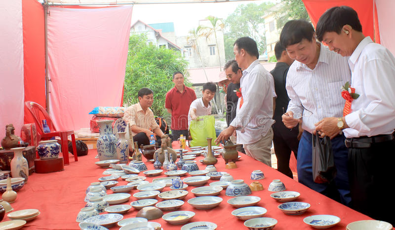 HAI DUONG, VIETNAM, October, 27: People in antiques market on October 27, 2014 in Hai Duong, Vietnam. royalty free stock photos