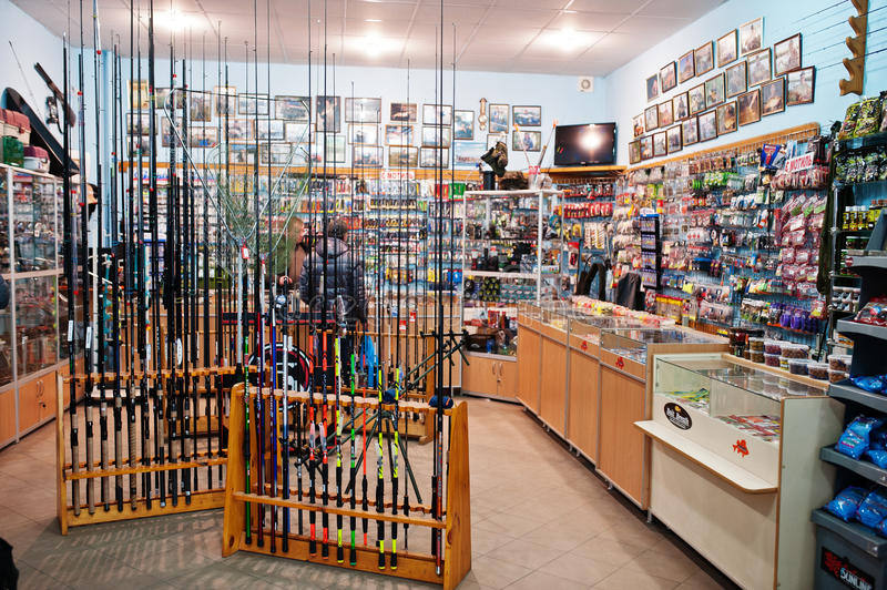 Hai, Ukraine - August 10, 2017: close-up photo of colorful fishing rods by Apache and Status in shop. royalty free stock photos