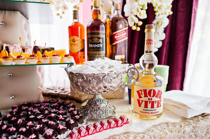 Hai, Ukraine - August 10, 2017: four bottles of alcohol by Pampero, Brandy, Red Label and Flor di Vite on the table in restaurant. stock photography