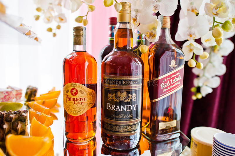 Hai, Ukraine - August 10, 2017: three bottles of alcohol by Pam. Pero, Brandy and Red Label on the table in restaurant royalty free stock photography