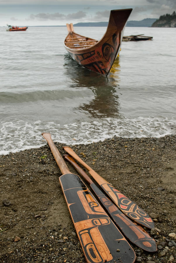 Free Haida Canoe And Paddles. Royalty Free Stock Image - 52862506