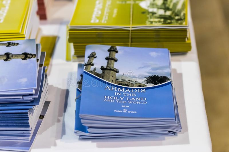 Books about Islam in different languages are on the table in the Ahmadiyya Shaykh Mahmud mosque in Haifa city in Israel. Haifa, Israel, July 11, 2019 : Books stock photography